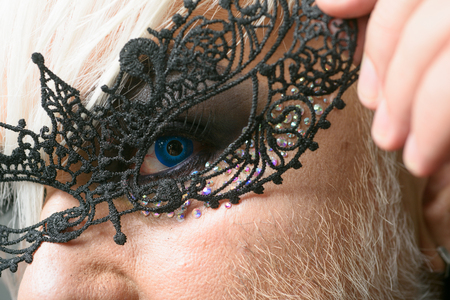 All the freaky people make the beauty of the world. Fetish fashion. Transgender man wear lace mask. BDSM fashion accessory. Heterosexual man with male makeup. Glamorous trashy look 版權商用圖片