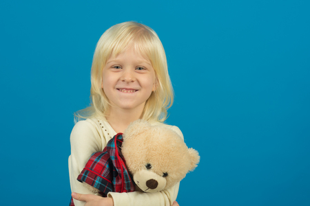 Playing with her toy. Little child with soft toy. Small kid happy smiling. My favorite childhood toy. Little girl with teddy bear. Small girl hold toy bear. Happy childhood, copy space