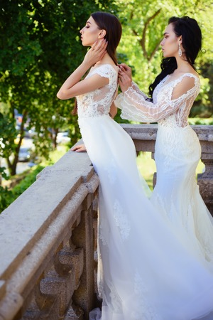Elegant wedding salon is waiting for bride. women is preparing for wedding. Beautiful wedding dresses in boutique. Happy bride before wedding. Wonderful bridal gown. Feeling grateful Stock Photo