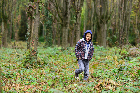 Every day is a journey. Little boy walk in woods. Little boy enjoy autumn day. Childrens leisure activities outdoor. Childrens day care. International childrens day Imagens