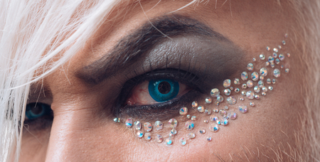 Weird and wonderful. Exotic transgender man wear eyeshadows and eyebrow makeup. Man eyes. Male makeup look. Fashion male eye makeup. The taboo around male makeup is disappearing