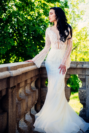 Elegant wedding salon is waiting for bride. Happy bride before wedding. Wonderful bridal gown. Beautiful wedding dresses in boutique. woman is preparing for wedding. Happy moment. Engagement Stok Fotoğraf