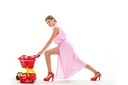 woman going to make payment in supermarket. shopping girl with full cart. savings on purchases retro woman go shopping. vintage housewife woman isolated on white. Incredible time while shopping