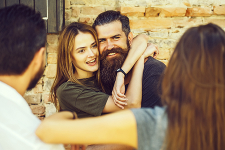 smilling couple with friends Imagens