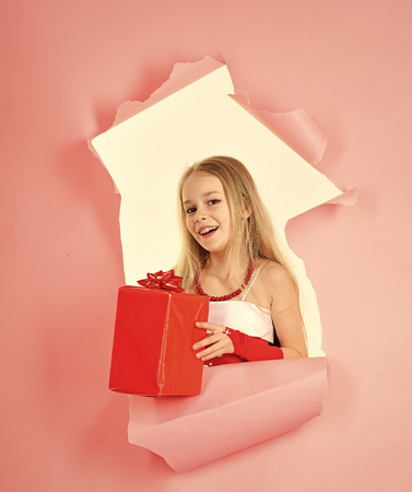 Boxing day, holiday celebration and party. Small girl with shopping package, black friday. Birthday and christmas. Child girl with present pack, cyber monday. Childhood and happiness, gift box.