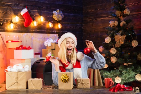 Happy girl preparing to celebrate new year and merry christmas. Surprised woman with christmas gift. We wish all visitors merry Christmas and happy new year. Stock Photo