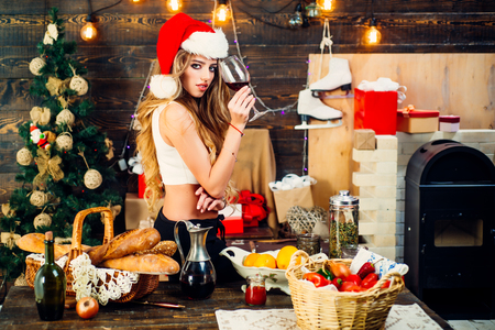 Happy girl preparing to celebrate new year and merry christmas. Christmas hot mulled wine.