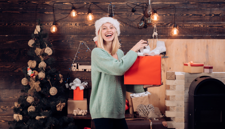 Happy girl preparing to celebrate new year and merry christmas. Christmas tree on home wooden background. Christmas eve.