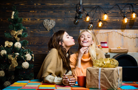 Funny girls and friendship concept. Group of friends celebrating new year and merry Christmas. Christmas wishes come true if you believe.