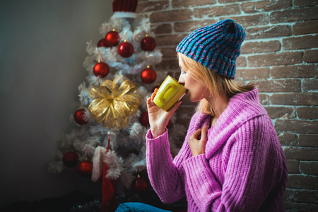 Christmas hot mulled wine. Happy girl celebrate new year and merry christmas. Hot wine and winter drinks. Knitted sweater for the new year.
