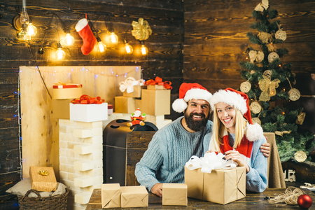 Happy family preparing to new year and merry Christmas. I want to give you your Christmas present. We begin the new year in that spirit of hope. Stock Photo - 111535938