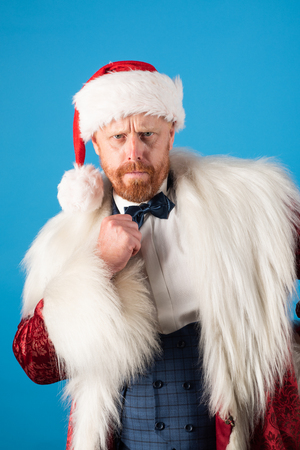 Christmas wishes come true if you believe. Santa with Christmas suit. Isolated for background.