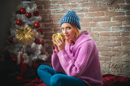 Christmas hot mulled wine. Hot wine and winter drinks. Poor thing, traveling on Christmas Eve. Knitted sweater for the new year. Stock Photo