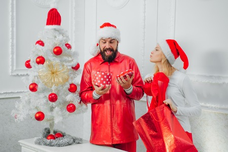 Happy family preparing to new year. Christmas holiday party. Santa claus in modern red jacket. Xmas fashion. Christmas wishes come true if you believe. Stok Fotoğraf