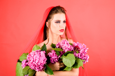 Makeup cosmetics and skincare. Beauty salon and hairdresser. Fashion jewelry and accessory. Fashion portrait of woman. woman with fashion makeup hold spring flowers. She is really cute Stock Photo