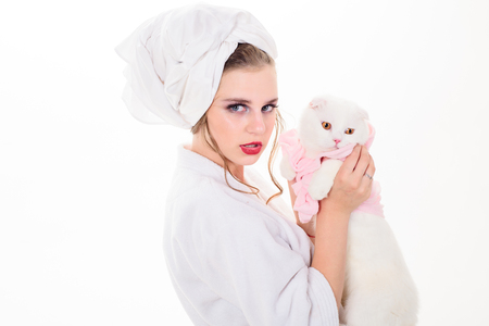after bath. woman with fashion makeup hold white cat. Makeup cosmetics and skincare. Fashion jewelry and accessory. Beauty salon and hairdresser. Fashion portrait of woman. Everything must be perfect Reklamní fotografie