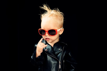Rock music is in my soul. Rock style child. Little child boy in rocker jacket and sunglasses. Little rock star. Rock and roll fashion trend. Adorable small music fan. Music for children Banque d'images - 111694577