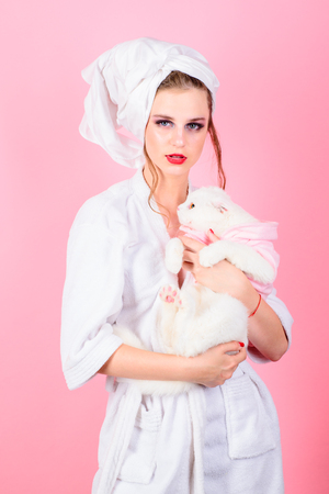 Makeup cosmetics and skincare. Beauty salon and hairdresser. Fashion jewelry and accessory. Fashion portrait of woman. woman with fashion makeup hold white cat. She is really cute. morning bath. Imagens