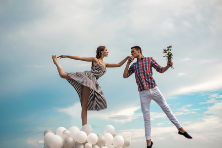 Dancing in the sky. Couple in love. Ballet couple into love relations. Ballet dancers falling in love. Romantic relations between ballerina and ballet partner. This is where I wanna be with you