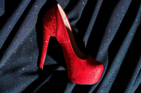 red shoes for lady. shopping. Shoes shop. fetish and love. woman in shoe store. shoe fashion. Desire. Following her personal style. Confident beauty. Beautiful female. Confident in her choice Stock Photo