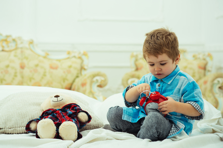 child play toys. happy childhood. Care and development. happy family and childrens day. Little boy playing with bear. little boy play at home. Family traditions. Best friends