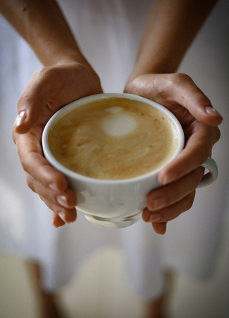 barista propose americano or espresso coffee cup. relax in cafe or coffee shop and drinking. Tastes delicious. perfect morning with best coffee. fresh morning coffee with milk and cream froth