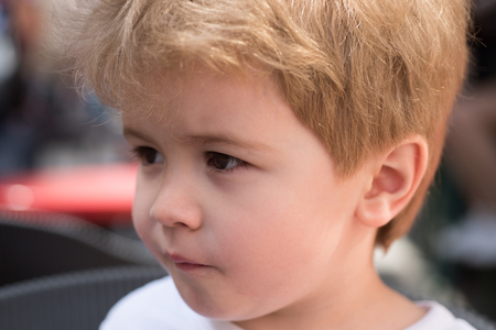 Caring for hair. Little child with stylish haircut. Little child with short haircut. Small boy with blond hair. Healthy haircare tips for kids. Haircare products. Everything for babys world