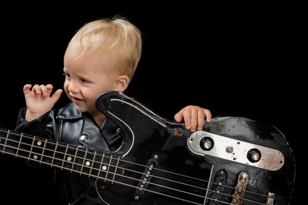 Music festival. Rock style child. Little rock star. Child boy with guitar. Little guitarist in rocker jacket. Rock and roll music performer. Adorable small music fan. Small musician Stockfoto