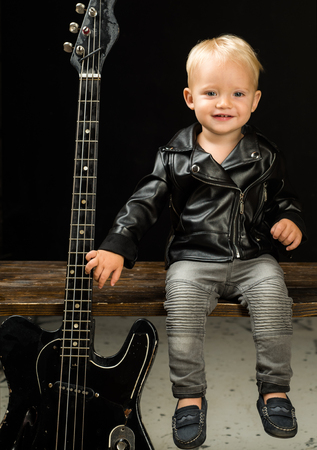 Im not prince Im rock and roll star. Child boy with guitar. Little guitarist in rocker jacket. Rock style child. Rock and roll music performer. Adorable music fan. Small musician. Little rock star