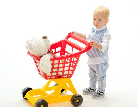 happy childhood and care. little boy child in toy shop. shopping for children. savings on purchases. little boy go shopping with full cart. Real happiness. Male shopping. Catching the moment Stock Photo