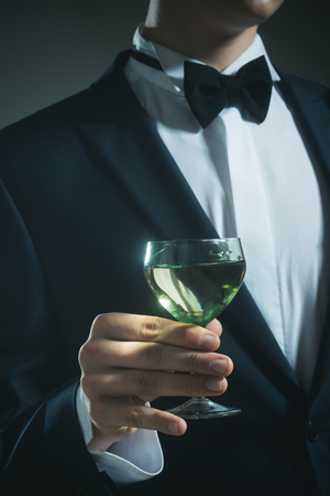 successful business meeting. Deal. wedding. Bride groom on husband with glass. man drink wine. formal male fashion. chears. To us. try this. somelier. party. Stock Photo