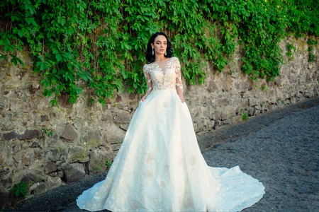 Wonderful bridal gown. Beautiful wedding dresses in boutique. Elegant wedding salon is waiting for bride. woman is preparing for wedding. Happy bride before wedding. Extremely happy Stock Photo