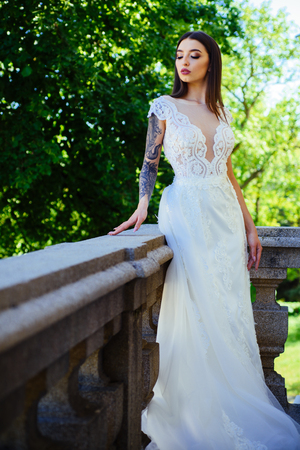 Happy bride before wedding. Beautiful wedding dresses in boutique. Wonderful bridal gown. woman is preparing for wedding. Elegant wedding salon is waiting for bride. Saying yes. Real admiration