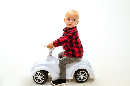 Simply just twist and go. Boy child on riding toy. Little child ride on toy car. Little baby enjoy playing in kindergarten. Small toddler builds balance and motor skills. Child day care or nursery