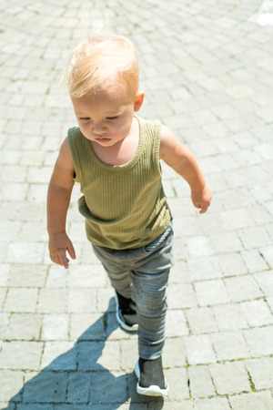 Being able to give good child care. Baby boy. Small baby on day care. Little baby walk outdoor. Improving child health and growth. Emotional and physical growth. Early child health care Stock Photo