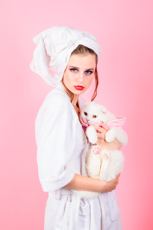 woman with fashion makeup hold white cat. Beauty salon and hairdresser. Makeup cosmetics and skincare. Fashion jewelry and accessory. Fashion portrait of woman. Everything must be perfect. morning.