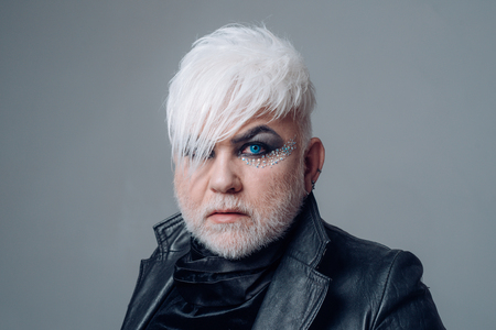 Gay rights are human rights. Bearded man with male makeup. Transgender person. Exotic hipster man with fashion hairstyle. Hipster fashion style. Support transgender rights. Male makeup look 版權商用圖片