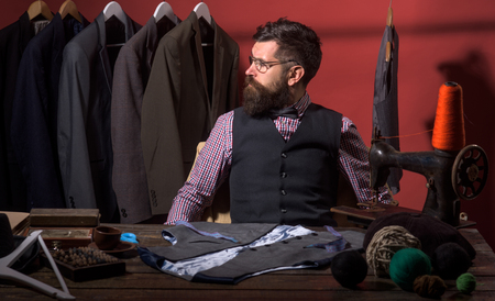 What design is better. business dress code. Handmade. retro and modern tailoring workshop. suit store and fashion showroom. sewing mechanization. Bearded man tailor sewing jacket. Perfect male