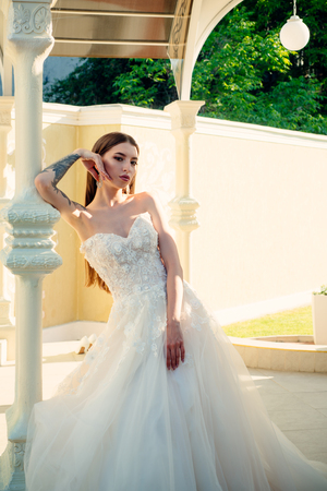 Elegant wedding salon is waiting for bride. Beautiful wedding dresses in boutique. Happy bride before wedding. Wonderful bridal gown. woman is preparing for wedding. Saying yes