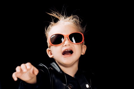 Stay wild and free. Little child boy in rocker jacket and sunglasses. Little rock star. Rock style child. Rock and roll fashion trend. Adorable small music fan. Music for children Stockfoto - 112525922