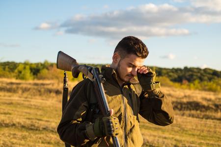 Hunter with shotgun gun on hunt. American hunting rifles. Hunting without borders. Stock Photo