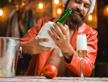 Handsome Christmas Santa Claus. Happy people partying. Wish you merry christmas.