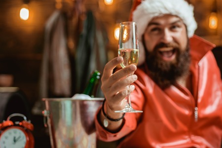Handsome Christmas Santa Claus. Happy people partying with champagne. Merry christmas and Happy new year. Wish you merry christmas. Stock Photo