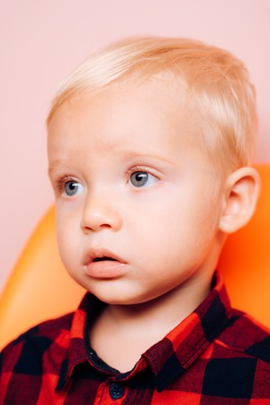 Small baby boy with adorable face. Early childhood development.
