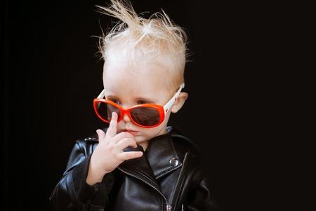 Adorable small music fan. Music for children. Little rock star