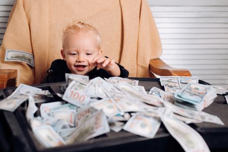 Little boy count money in cash. Little entrepreneur work in office Stok Fotoğraf - 111836664