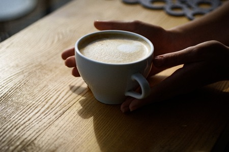 relax in cafe or coffee shop and drinking.