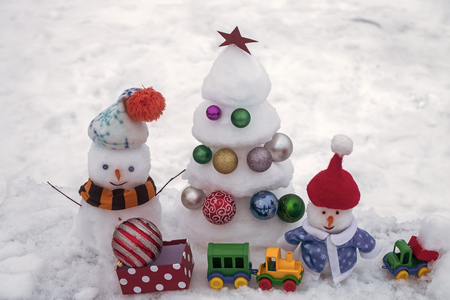 Christmas tree with balls, present box, toy train and car Stock Photo