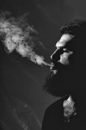 Bearded man with smoke