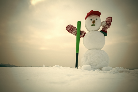 New year snowman from snow in cap and mittens.